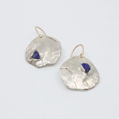 Lapis lazuli set in sterling silver with gold fill wire hook.  approx. 1 x 1 inch