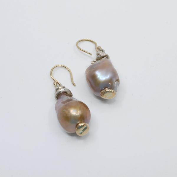 Cultured pearl with 10k yellow gold and silver details.  approx. 1 x 0.5 inches