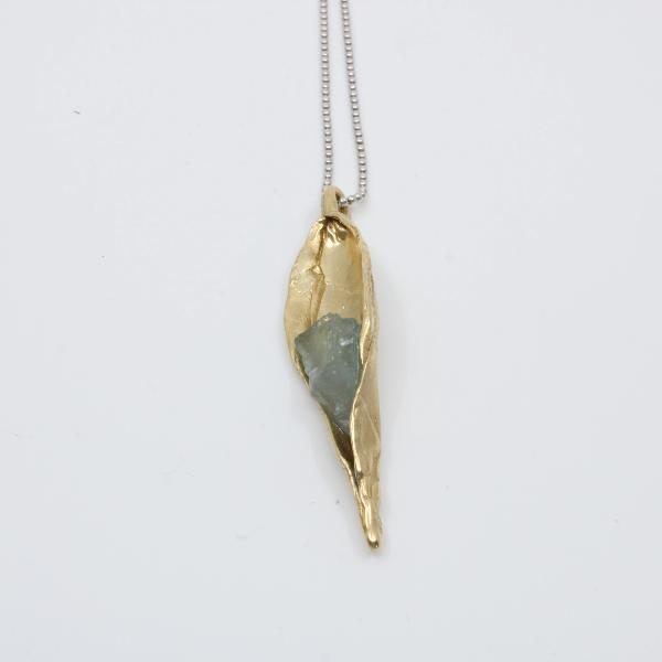Rough aquamarine in bronze pea pod with a sterling silver rhodium chain Pendant 1 x 0.5 inches with 20 inch chain
