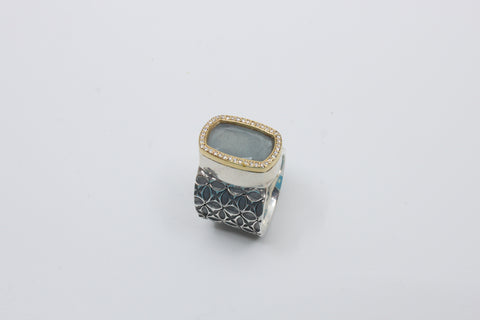 Ring with aquamarine and diamonds in 18 k gold setting. Sterling silver band.  Size 7.25