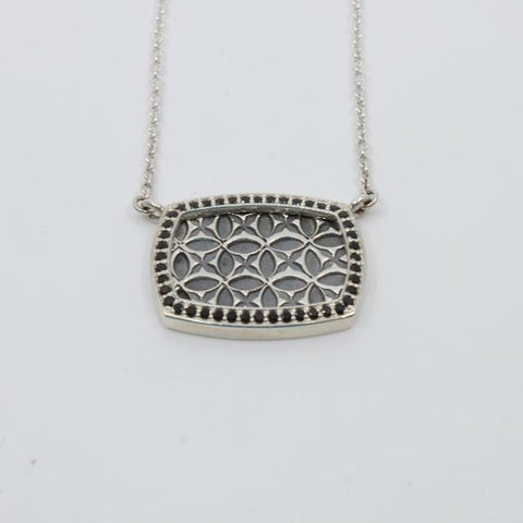 Necklace with black spinels set in sterling silver around a stamped pattern.