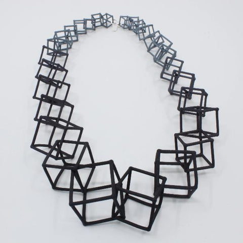 "Gradated nylon cube .22"" necklace in black and grey."