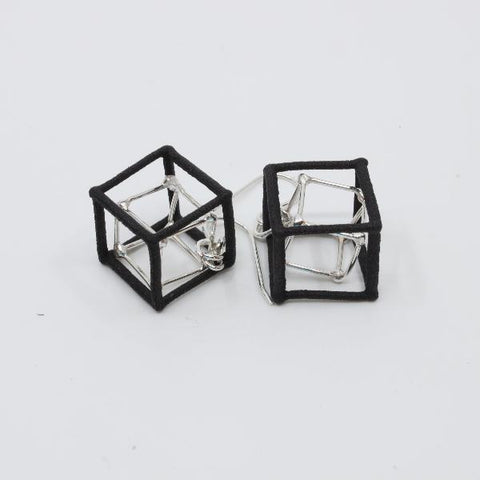 Sterling silver and nylon double cube earrings.