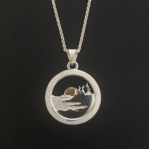 Shoreline pendant in sterling silver with a 24k gold sun.  Pendant is  3 mm diameter