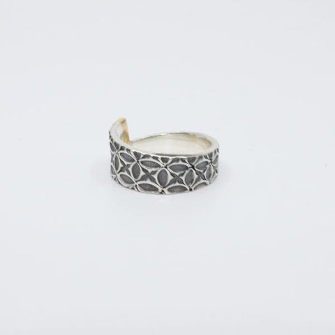 Ring with 4 diamonds in 18 k gold setting. Sterling silver band.stamped.  Size 7.5