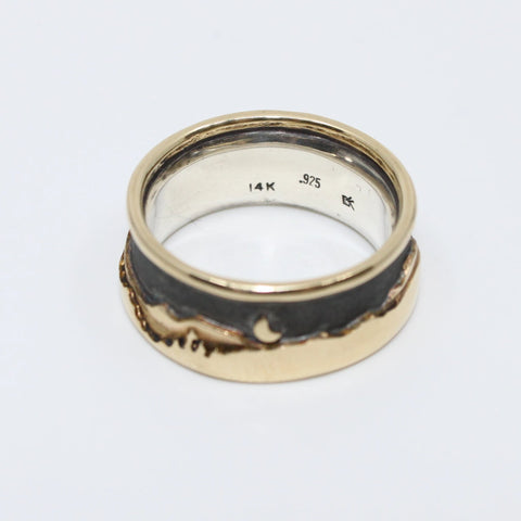 Landscape at night ring with a soft black sky showing beautifully the layers of detail in the 14K gold hills, trees and water with an island, a full and a half moon. Size 9 with a 9.5 mm width.