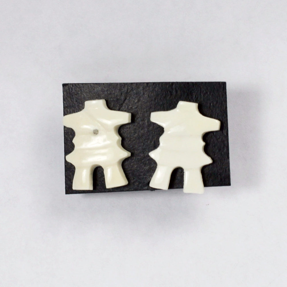 Inukshuk earrings in walrus ivory by Levi Nowdluk.