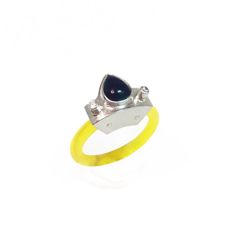 Anna Lindsay MacDonald ring in acrylic, black opal, and cubic zirconia.