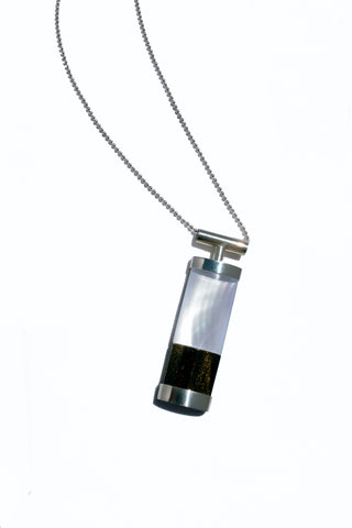 Lantern Pendant hand fabricated in sterling silver and acrylic with mother-of-pearl detail. The simplicity results in a sleek and classic look.