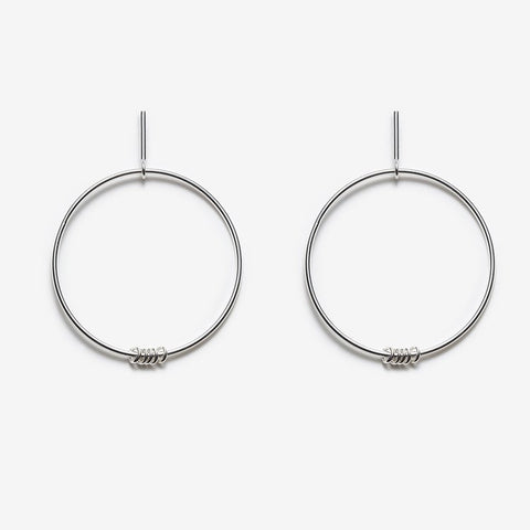 Ilidi earrings are a large drop hoop with five small mini loops made from sterling silver and measure approximately 6 cm.