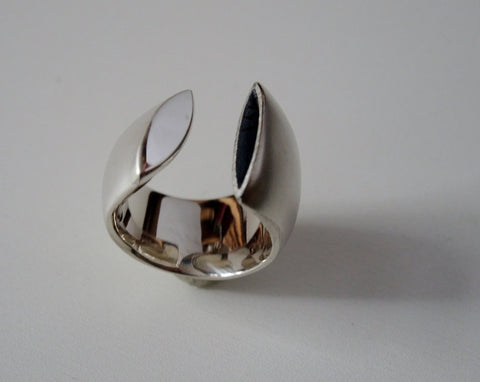 Large rounded and polished open band with one oxidized and one polished sterling silver end approx.18mm wide, size 6.5