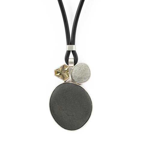 Lime quartz and pebble stone pendant in sterling silver on a rubber cord.,