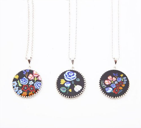 Lucie Weir's murrine glass pendants on sterling silver chains.  centre: blue and yellow bouquet, 23 mm diameter on a 44 cm rollo chain.
