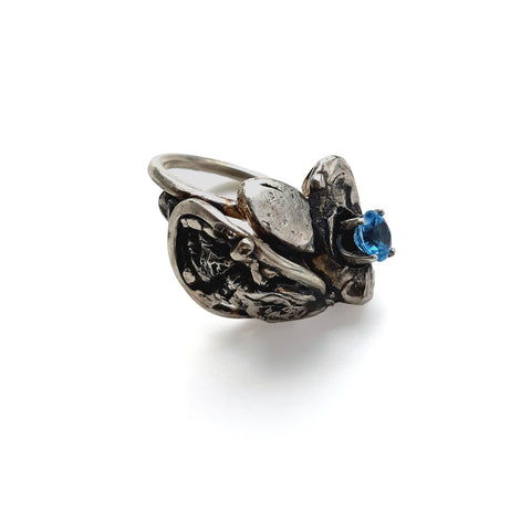 This ring by jewellery artist Meris Mosher is made with Silver and topaz