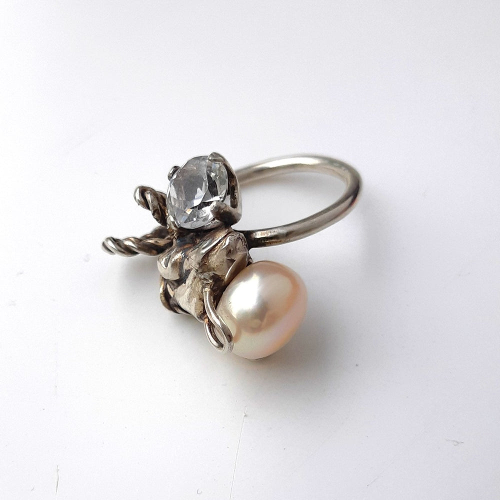 This ring by jewellery artist Meris Mosher is made with Silver, quartz, and a fresh water pearl