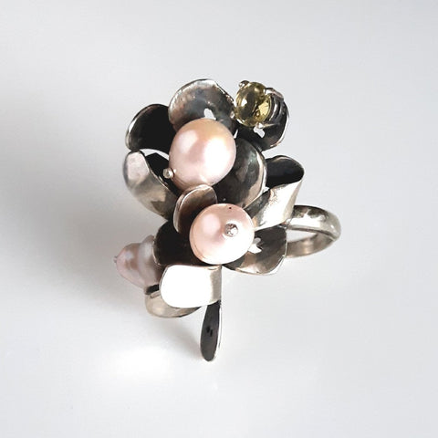 This ring by jewellery artist Meris Mosher is made with Silver, lemon quartz, and fresh water pearls
