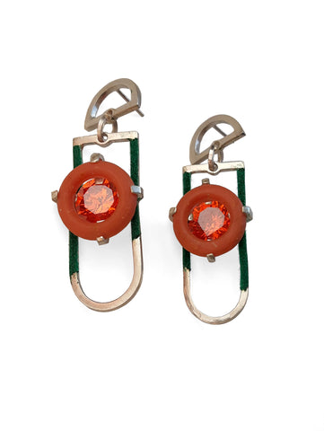 Pool Side Earrings. These fine and ready for fun stud drop earrings in sterling silver include coral resin rings with bright cubic zirconia pink-orange-red stones. Light on the ear, they measure 4.5 x 2. x 1 cm.