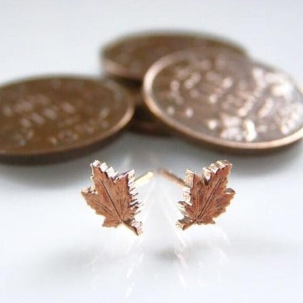 Penny leaf stud earrings made from vintage Canadian one cent coins and rose gold findings by Canadian artist Micah Adams.