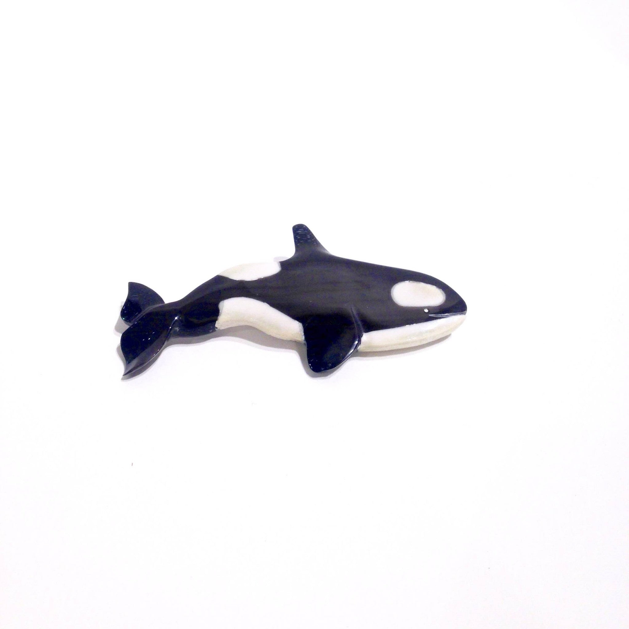 Killer Whale brooch made from Caribou antler by Andrew Nowdlak.