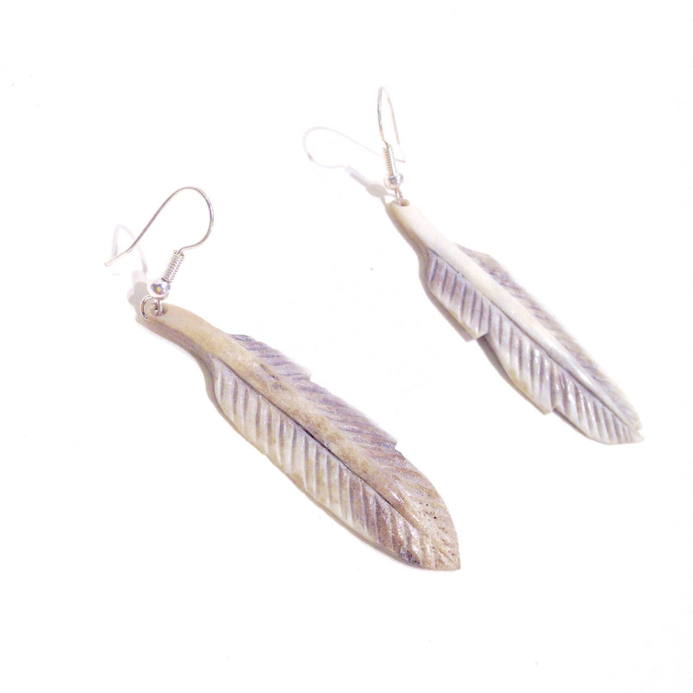 Feather drop earrings by Andrew Nowdluk.