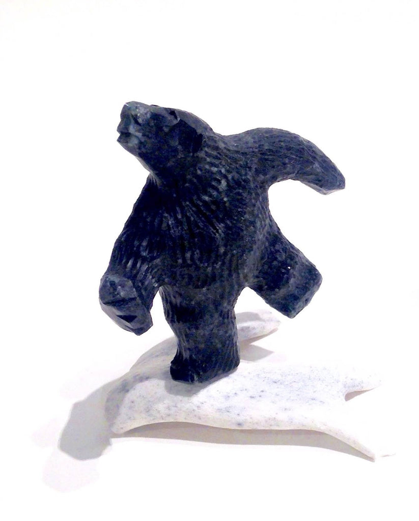 Running Bear carving  by Patrick Aula.