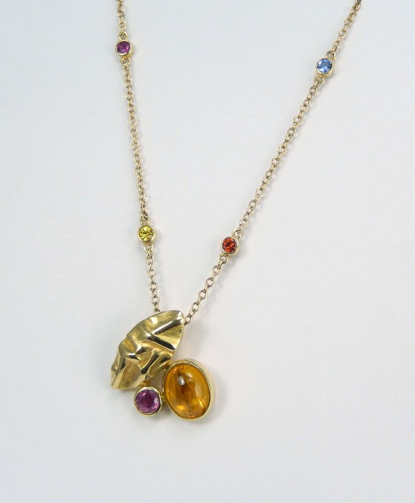 "Intricate pendant in 18k yellow gold with yellow and pink sapphires and a 21"" chain in 14k yellow gold that features 4 bezel set colored sapphires. Pendant and chain sold separately, priced at $3,750 for the pendant and $1,470 for the chain."