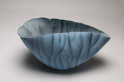 "Blue Canyon by Paula Murray is a multi-fired porcelain vessel with monumental presence. Side view.  8 x 9.5 x 9.5""."