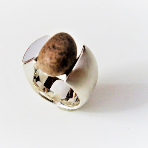 Pebble stone ring in a wide rounded sterling silver band. Size 7; 2 x 2 cm.