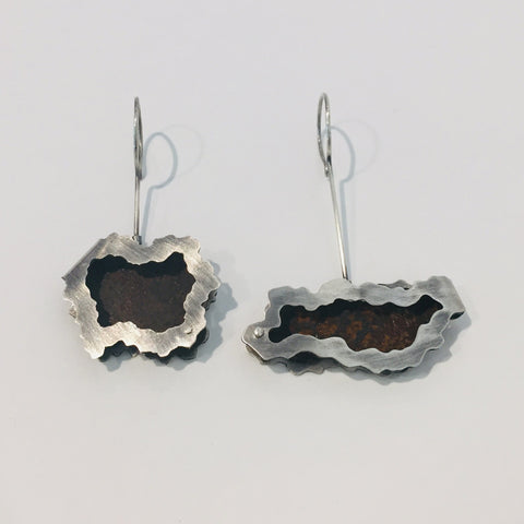 Folded dangling earrings, made from rust and sterling silver