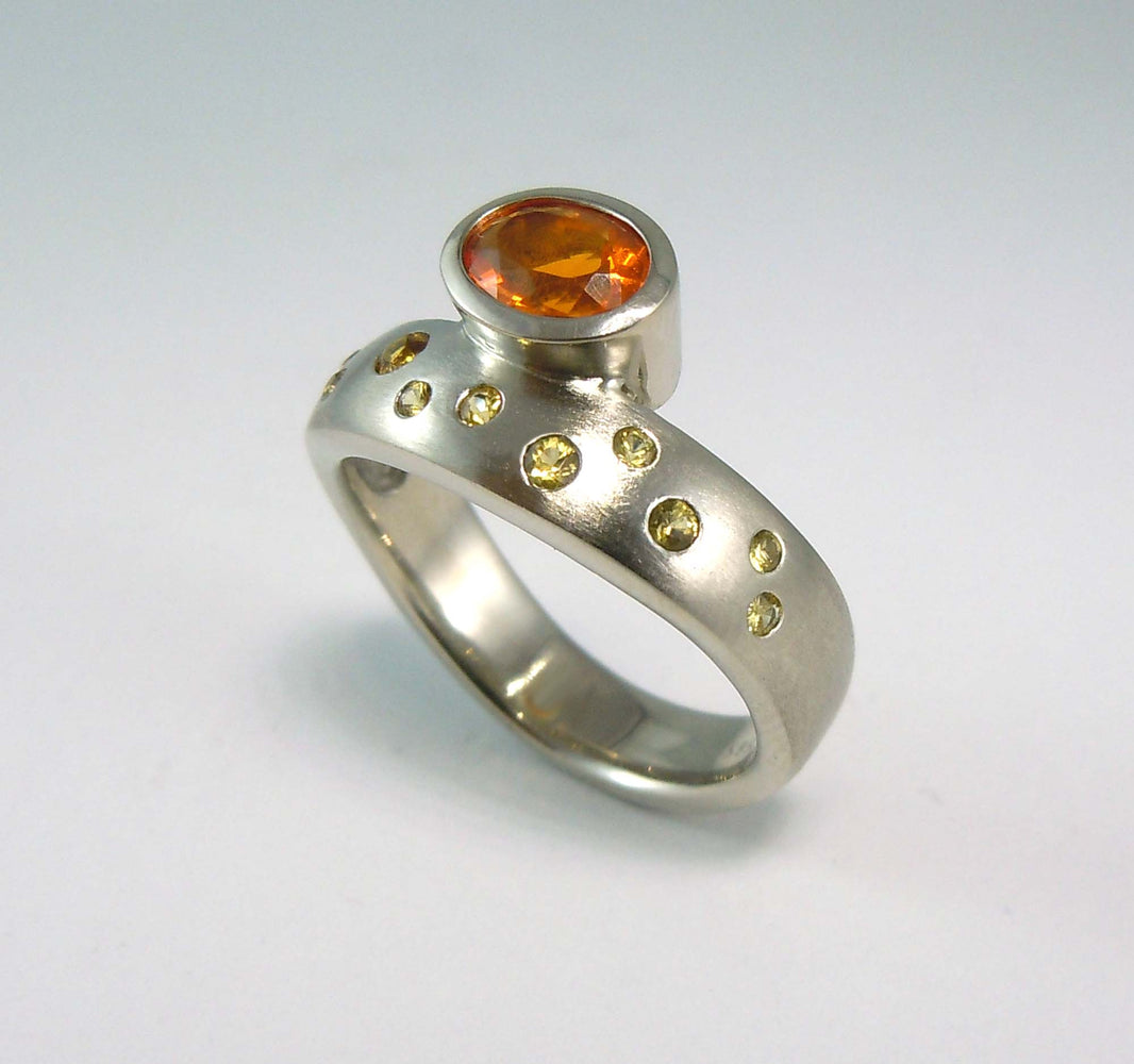 14k white gold ring with fire opals and yellow sapphires.