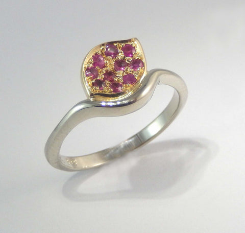 Delicate ring in 14k white gold with rubies set in yellow gold.