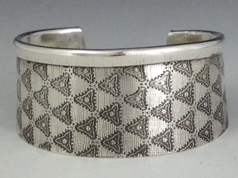 "A wide sterling silver cuff that celebrates pattern on texture, it 1 1/4"" or 32 mm in width."