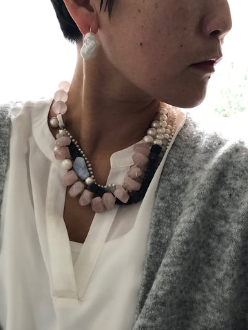 Exciting and soft colours in this necklace of rose quartz, lava bead, blue lace agate, and amethyst, hand-knotted between each bead And with a copper clasp; it is 48.5 cm.