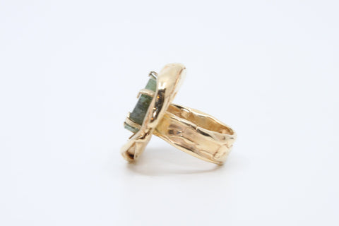 Sparkling Rosé, a substantial 14k yellow gold ring with a thick watermelon tourmaline slice set with irregularly spaced 14k gold prongs.  Size 6.75