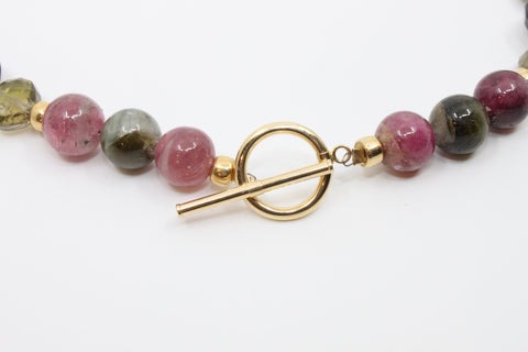 Luscious watermelon tourmaline beads strung together in the full range of pink and green, and interspersed with 18k and 14k spacer beads and an Italian 14k gold toggle clasp.