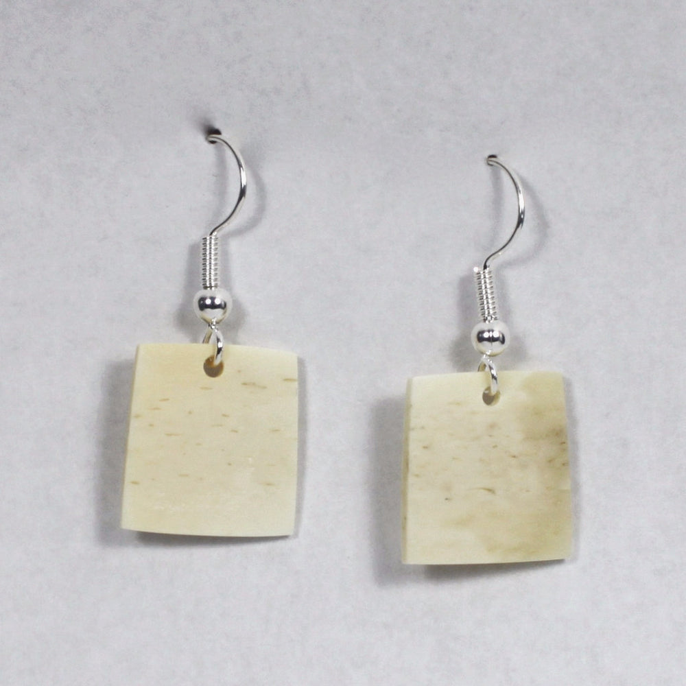 Square ivory earrings by Pootoogook Qiatsuq.