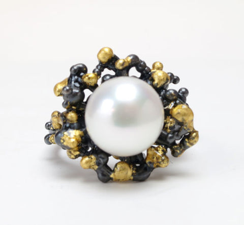 Tides Ring.   Sterling silver, patina, gold leaf sealed with resin, 9mm round freshwater pearl.