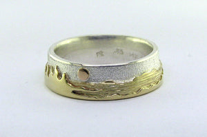 Two tone Shoreline Ring with a brushed sterling silver sky backdrop for the rugged mountains with moon, and sun above the trees and lake in impressive depths of polished 14k yellow gold.  Size 7.5, 8 mm wide.