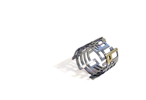 Interlaced ring in steel and 18k yellow gold by Canadian jewellery artist Anna Lindsay MacDonald.