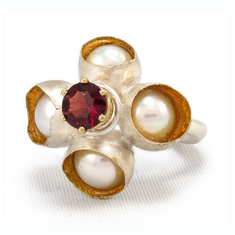 Queen of Hearts Ring. with a garnet surrounded by freshwater pearls that float in resin with 22k gold leaf interiors, 32 x 27 x 25mm, 6.75.