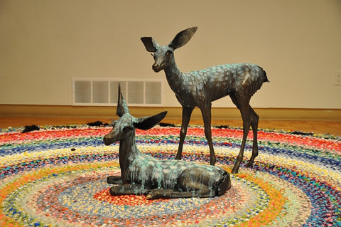 Dark Timber installation.  Two life-sized fawns on a hand-knotted rug.