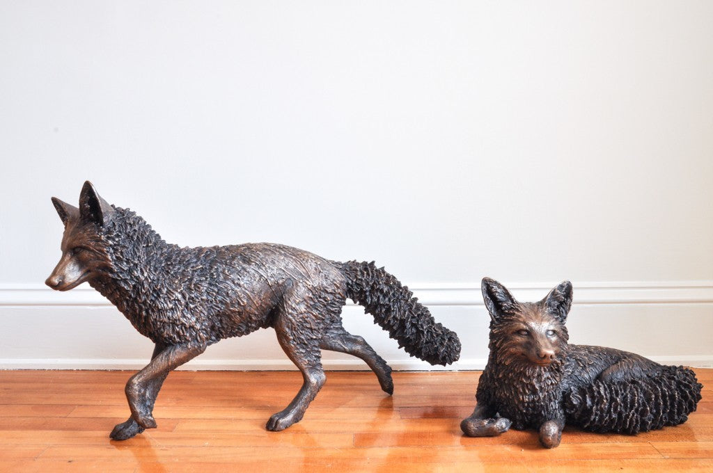 Boreal Visitors life-sized bronze sculptures of foxes, running and reclining.  Edition 1 of 3 has sold; contact the gallery regarding a new commission.