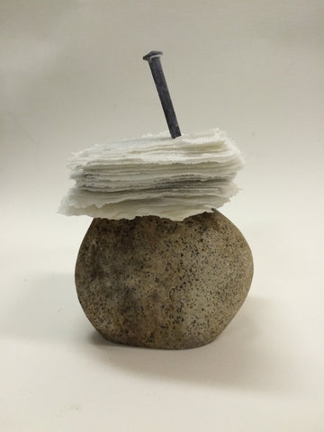 Balance?, cast glass sculpture with nail on a concrete base by Cheryl Wilson Smith.