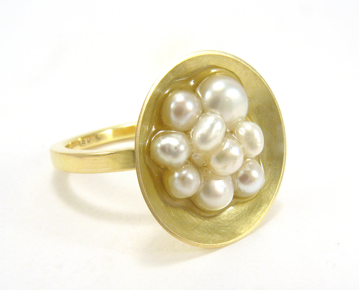 cluster of freshwater pearls set in 18k yellow cold cup by Annie Tung.