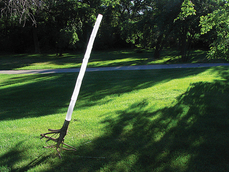 Arcadia reconstruction: from memory, with cast glass, tree root, and steel tube by Ione Thorkelsson.