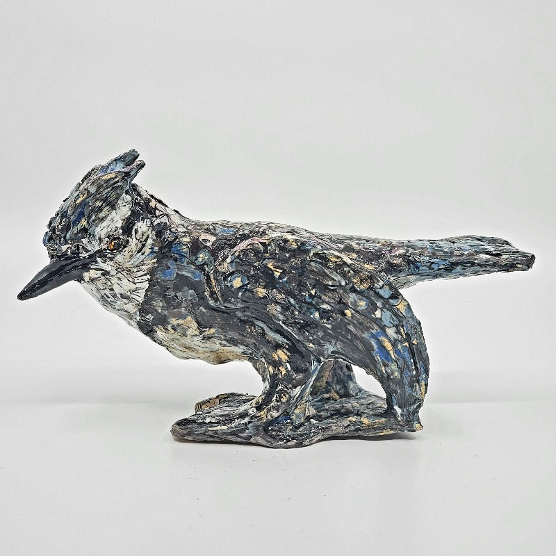 Blue Jay. A powerful small standing sculpture of a blue jay. Multi-fired, its plumage is rich with different layers of coloured slips and glazes, 14 x 26 x 8 cm.