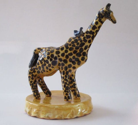 Giraffe from Happy Wild Animals series in glazed red earthenware clay by Mimi Cabri.