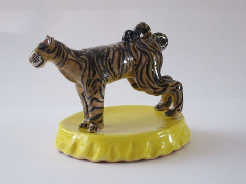 Tiger from Happy Wild Animals series in glazed red earthenware clay by Mimi Cabri.
