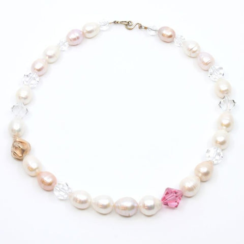 "Now and Then, 18"" neckpiece with large white, pink and peach freshwater pearls, a handmade 14k rose gold bead and signature clasp as well as clear and pink Swarovski crystal beads."