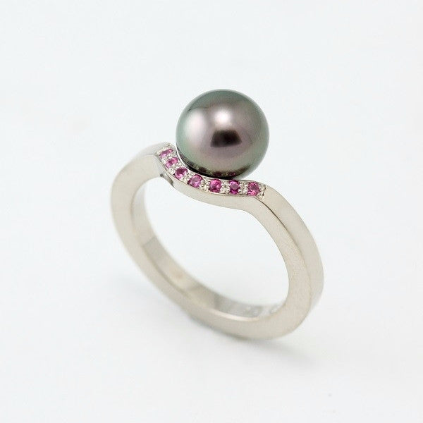 18k grey gold ring with pink sapphires and Tahitian pearl by Canadian jewellery artist Pierre-Yves Paquette.